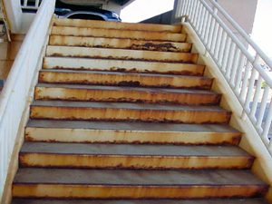 corroding staircase with rust bleeding