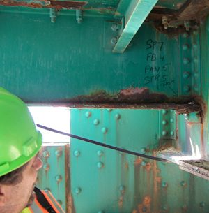 inspecting corrosion on a steel bridge