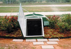 galvanized storm shelter buried in soil