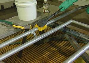 Cleaning the steel surface with a brush