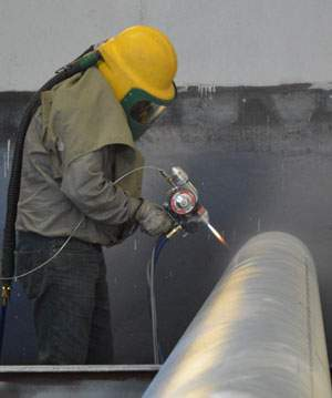 Zinc spray, which is also referred to as metallizing.